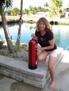 Micki Browning with her bright red SCUBA tank